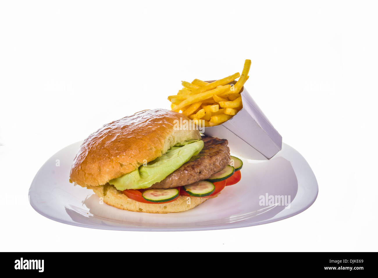 hamburger with salad and french fries on white plate - Stock Image