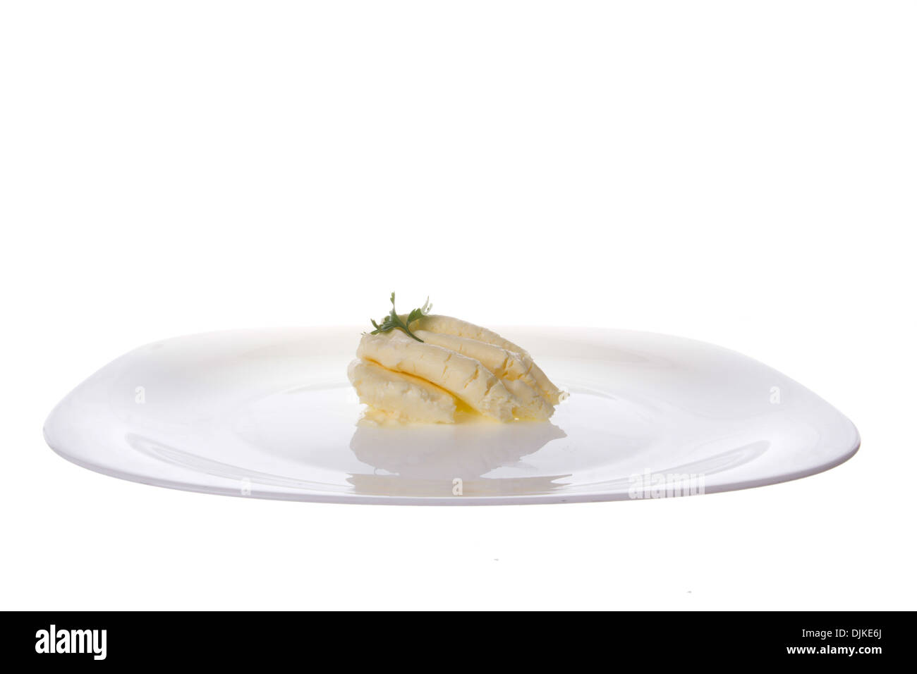 healthy cream cheese on the plate with parsley on top of it - Stock Image