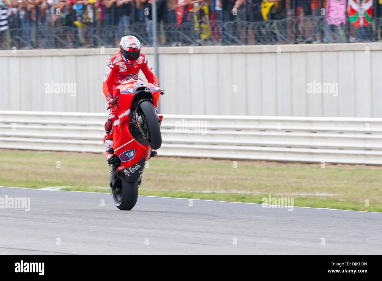 Sep. 07, 2010 - Misano Adriatico, Italy - Ducati rider Casey Stoner (USA #27) celebrate with a wheelie the 5th place of the San Marino GP in Misano Adriatico, Italy. (Credit Image: © Andrea Ranalli/Southcreek Global/ZUMApress.com) - Stock Image