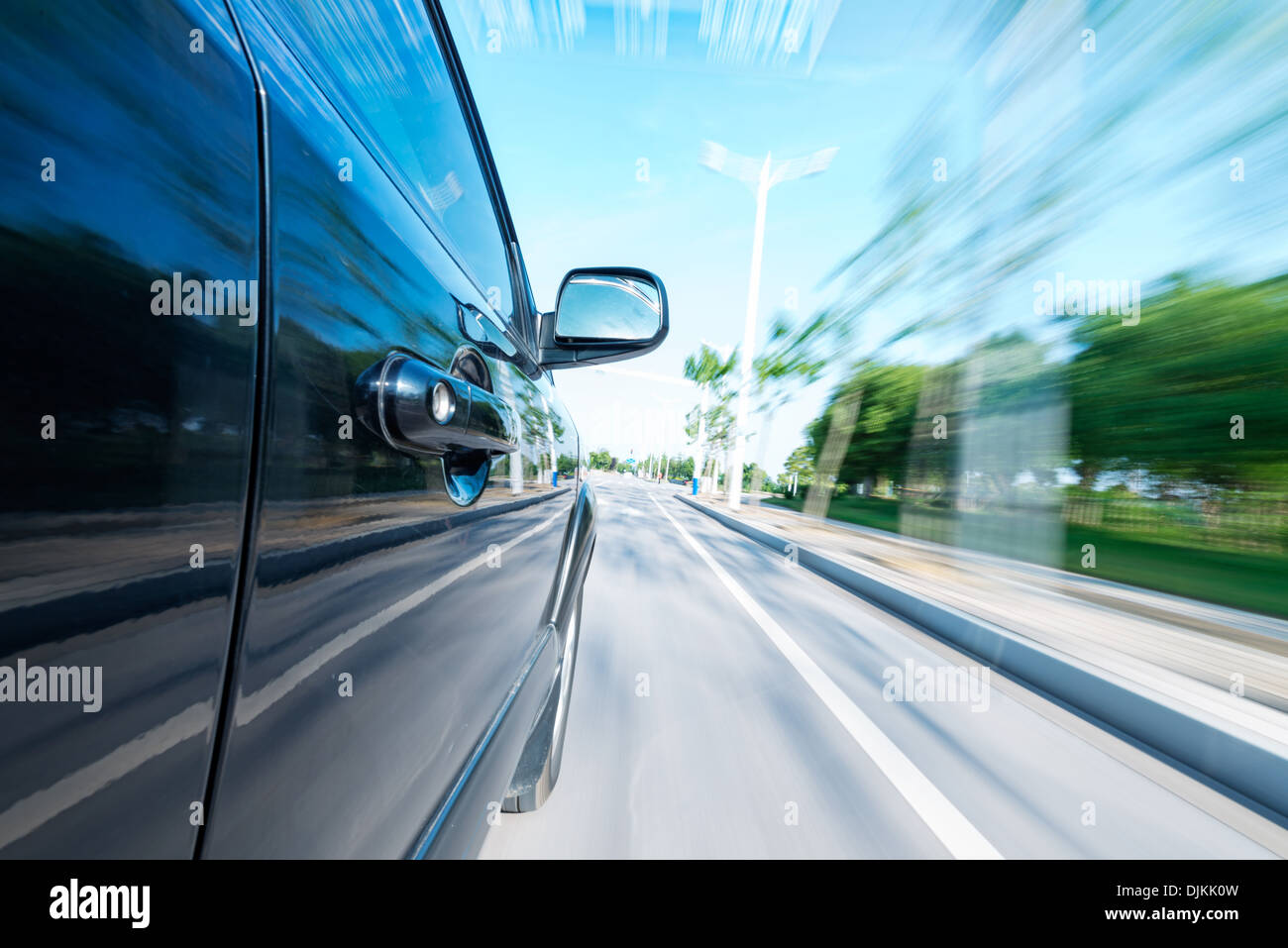car on the road with motion blur background - Stock Image