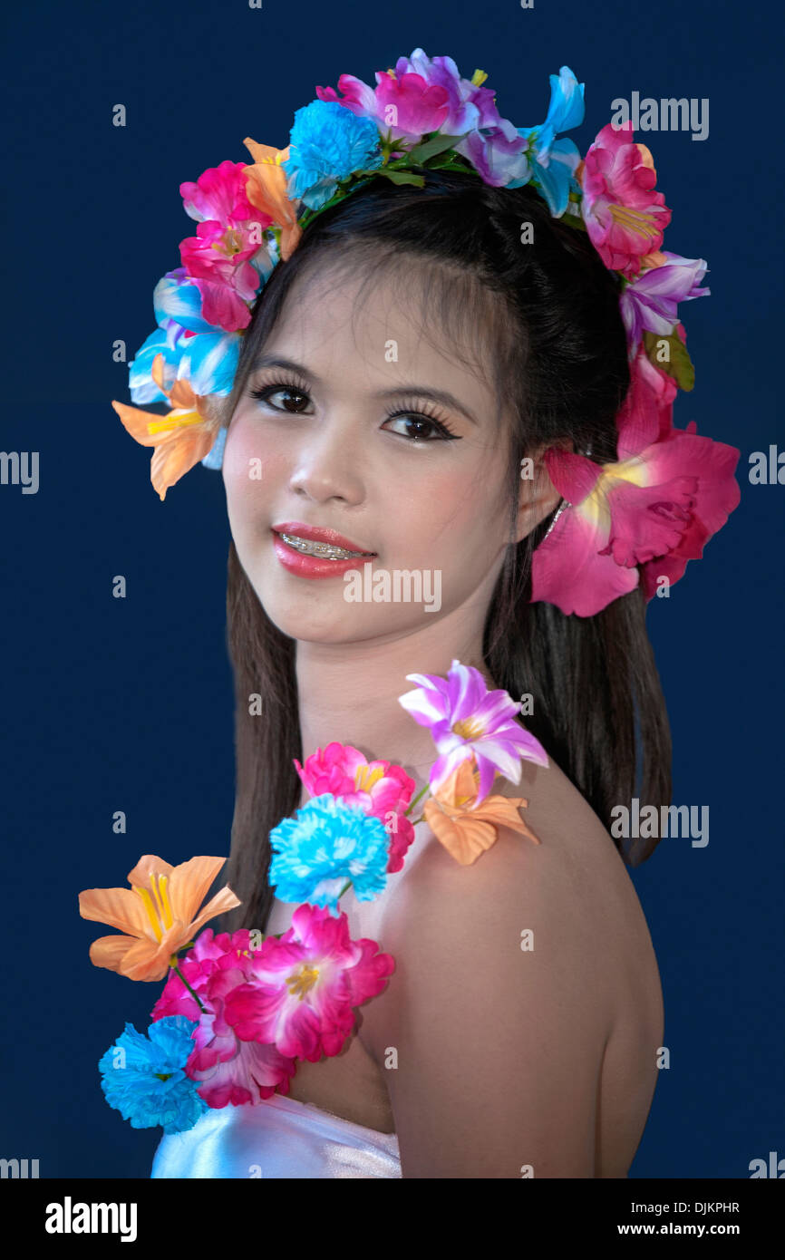 A young and beautiful thai girl with flowers in her hair thailand a young and beautiful thai girl with flowers in her hair thailand southeast asia izmirmasajfo Image collections