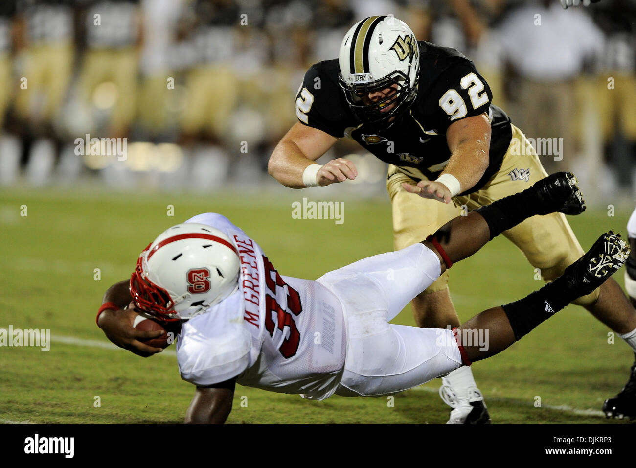 Sept. 11, 2010 - Orlando, Florida, United States of America - North Carolina State Wolfpack running back Mustafa Greene (33) dives ahead past UCF Knights defensive lineman Barry Snider (92) during the game at Brighthouse Arena in Orlando,   in which NC State defeated UCF 28-21. (Credit Image: © Brad Barr/Southcreek Global/ZUMApress.com) - Stock Image