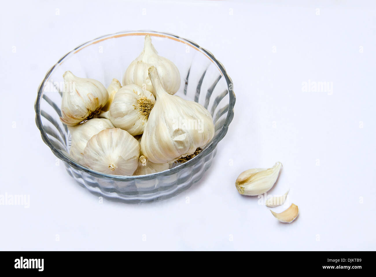 Strong-smelling, pungent-tasting bulbs of garlic used as flavoring in cookery - Stock Image