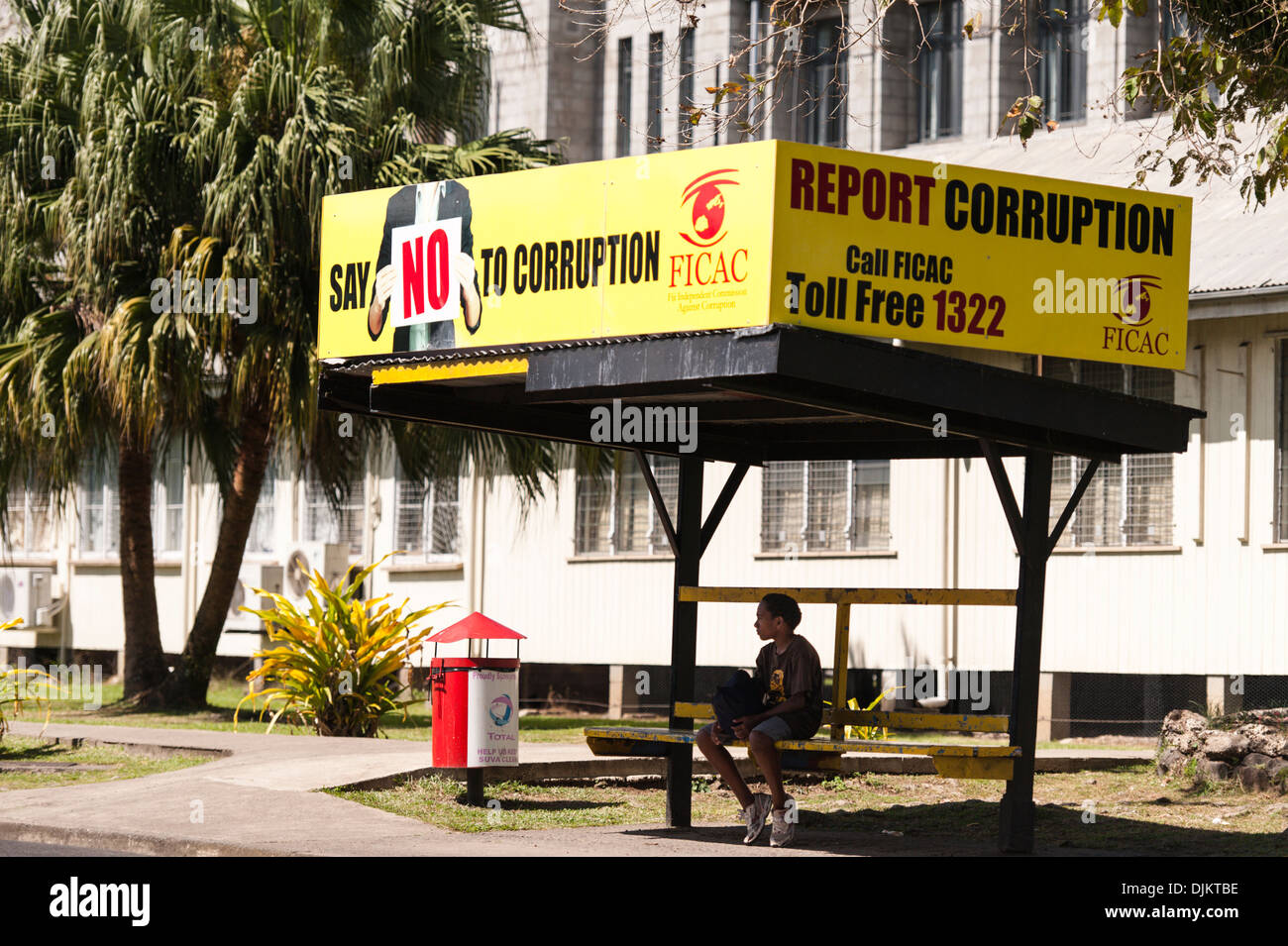Anti Corruption signs on a bus stop outside the Ministry of Justice building, Suva, Fiji. - Stock Image