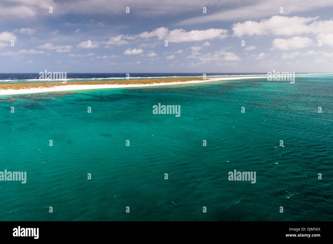 Mast top view of sandy beach on Huon Island and Huon Atoll, looking south east with the South Pacific beyond. New Caledonia - Stock Image