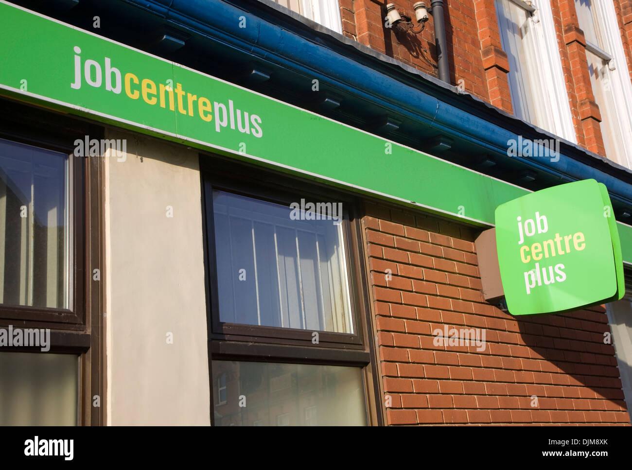 Close up Job Centre Plus green sign on building exterior wall UK Stock Photo