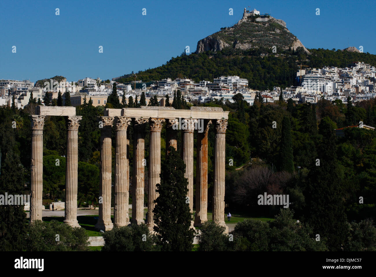 Temple of Olympian Zeus. The historic center of Athens from Hotel rooftops. - Stock Image