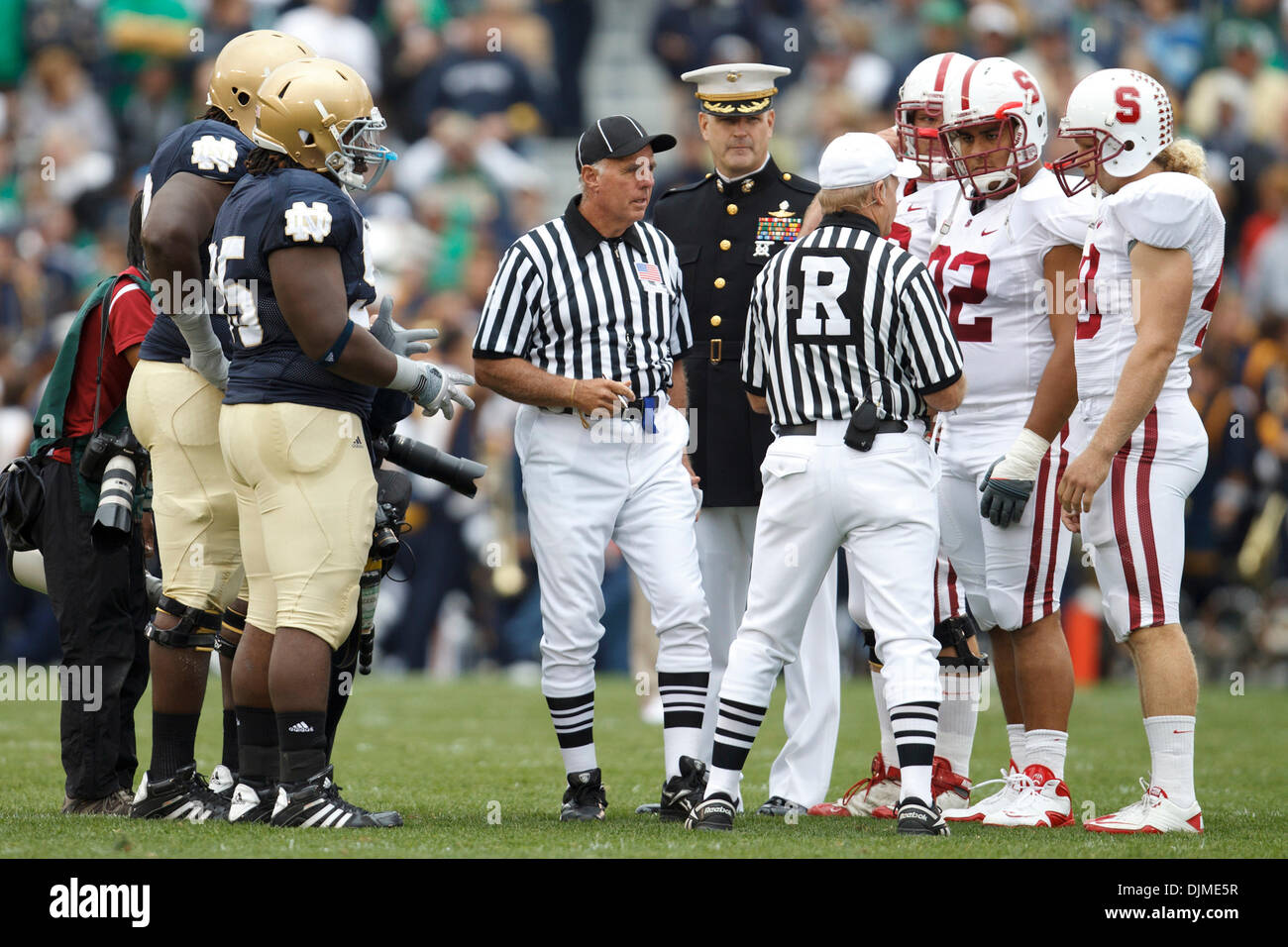 Sept. 25, 2010 - South Bend, Indiana, United States of America - Coin flip prior to NCAA football game between Stanford and Notre Dame.  The Stanford Cardinal defeated the Notre Dame Fighting Irish 37-14 in game at Notre Dame Stadium in South Bend, Indiana. (Credit Image: © John Mersits/Southcreek Global/ZUMApress.com) - Stock Image
