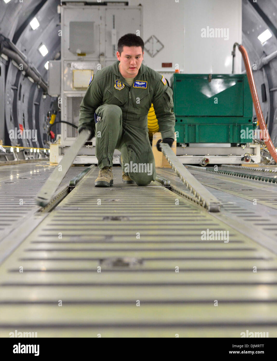 Air Force Reserve Senior Airman Travis Shea, 709th Airlift Squadron loadmaster student, prepares the cargo floor Stock Photo