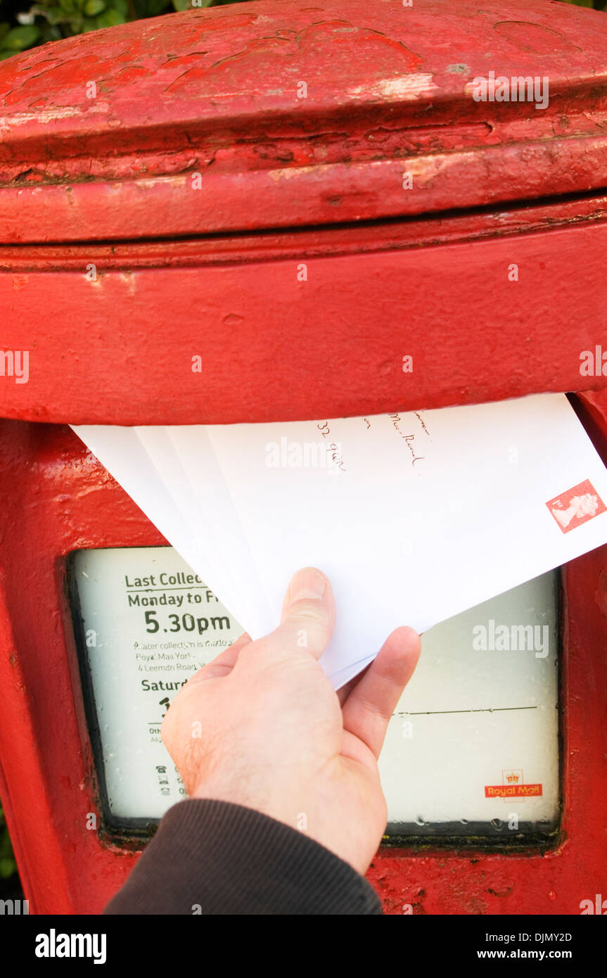post office letter box red letterbox postbox boxes posting a letter letters royal mail mailbox uk red share issue hand stamp sta - Stock Image