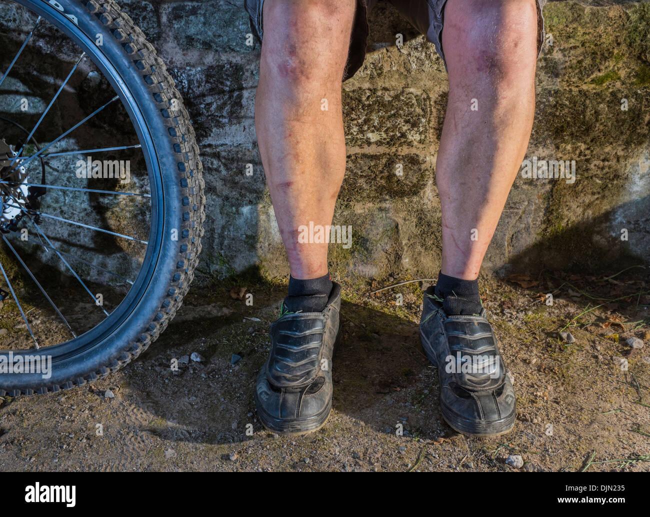 Male mountain biker resting. Stock Photo