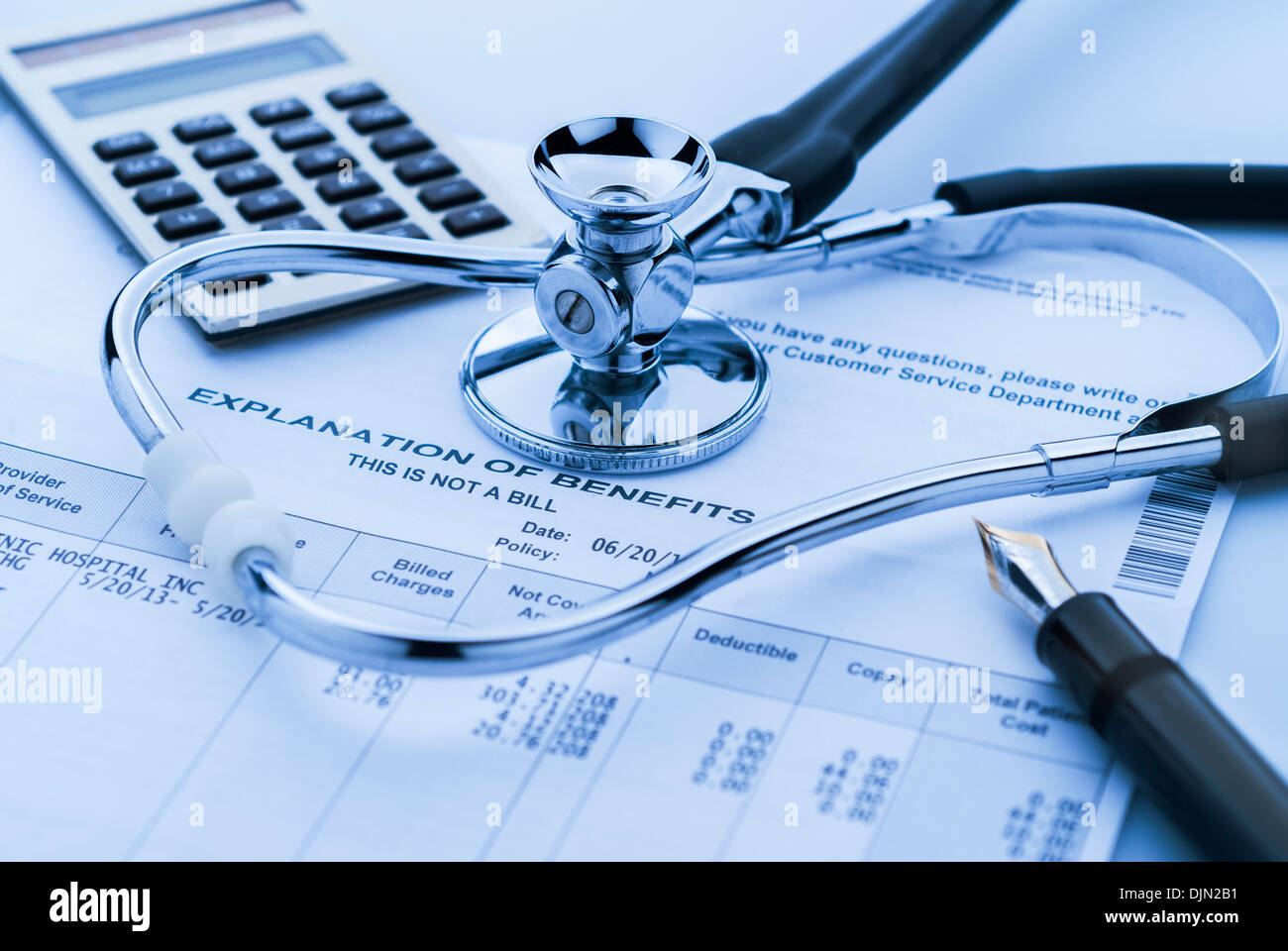 Cost of health care with stethoscope, calculator and pen - Stock Image