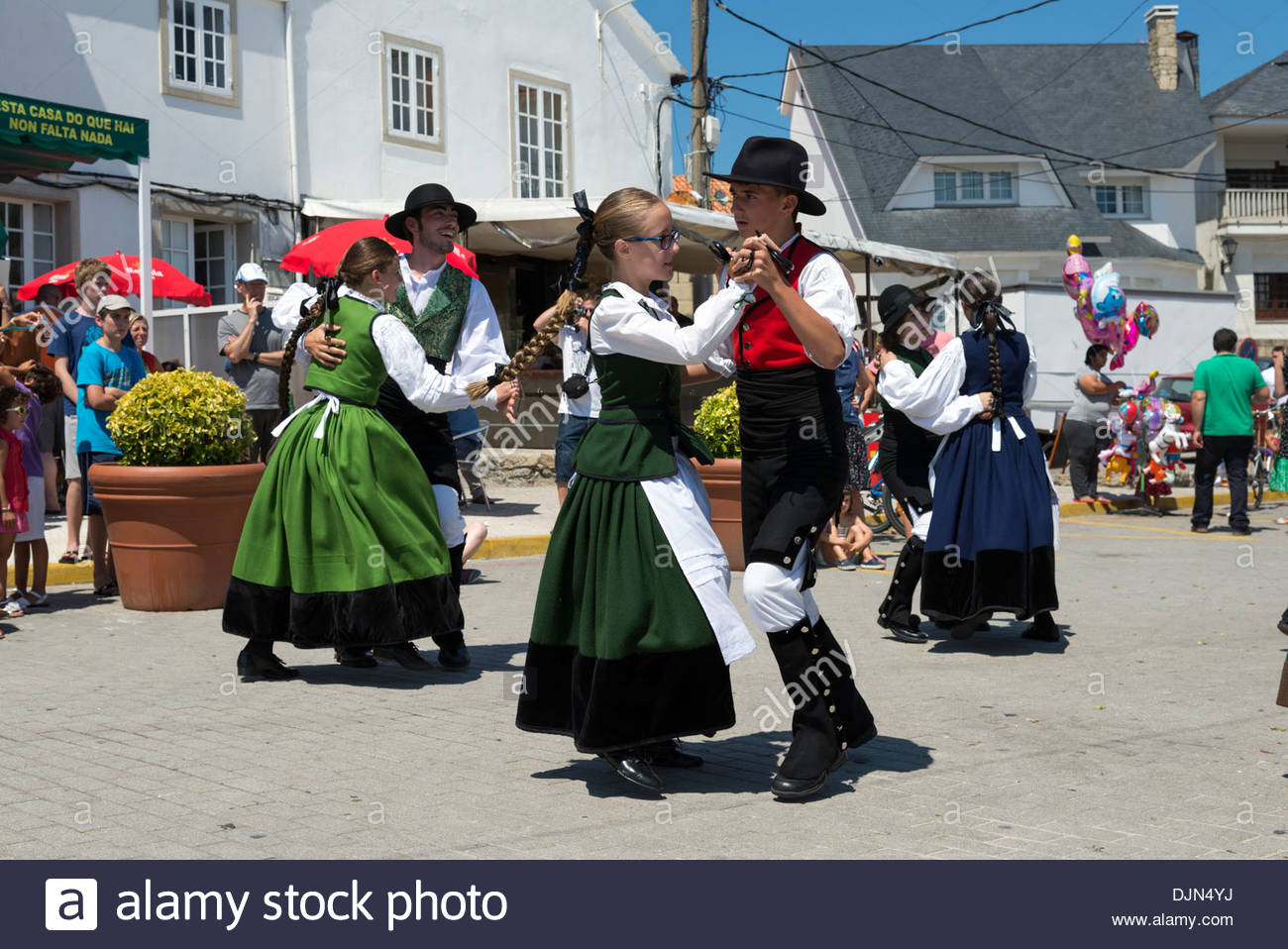 Young people performing traditional folk dance during annual fiestas, Corrubedo, Galicia, Spain - Stock Image