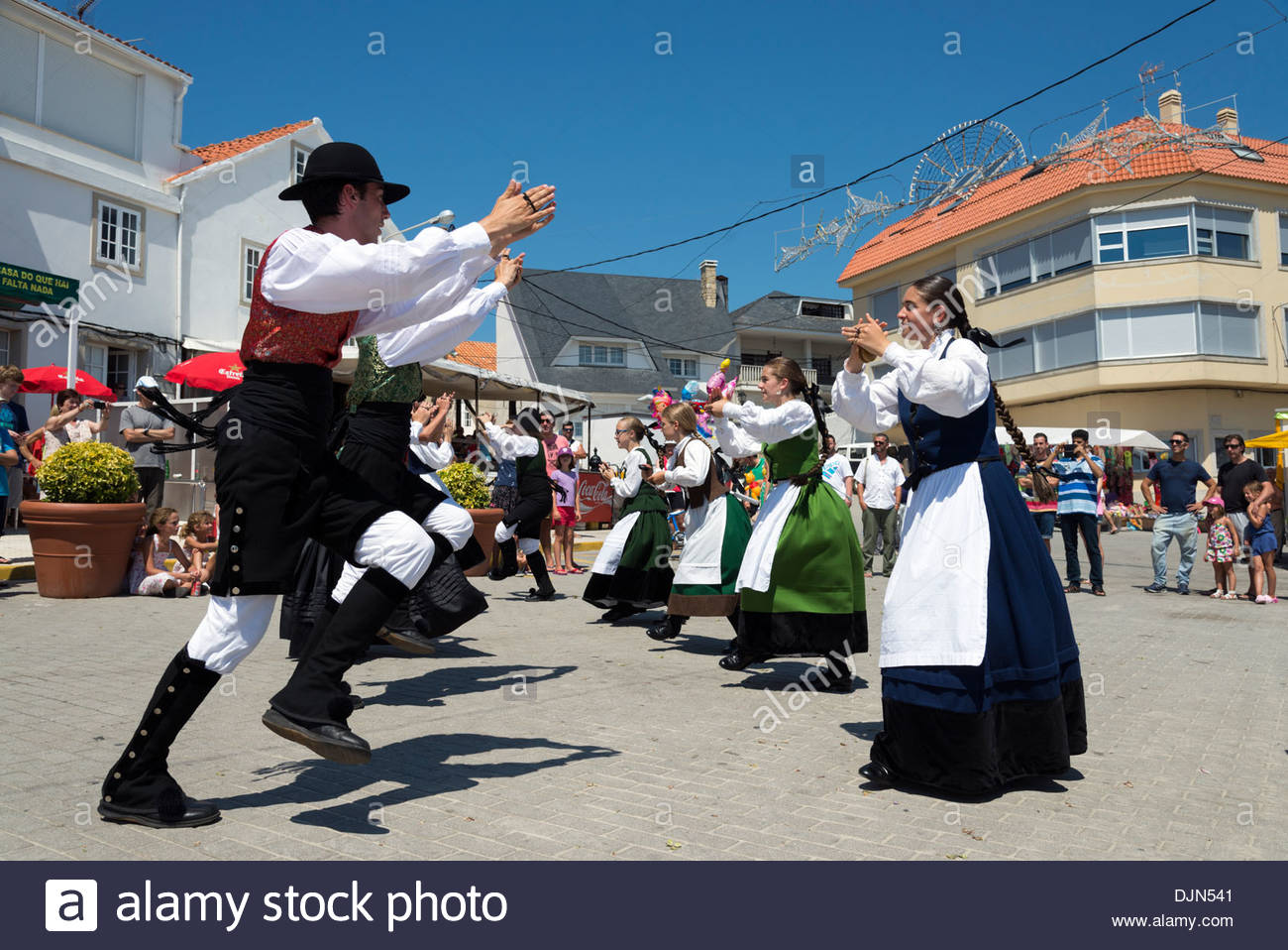 Young people performing traditional folk dance during annual fiestas, Corrubedo, Rias Baixas, Galicia, Spain - Stock Image