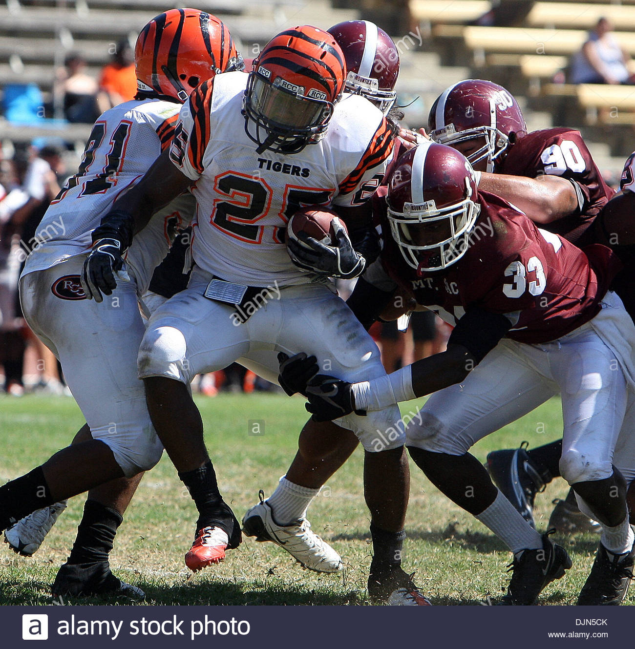 Mar. 20, 2008 - Walnut, California, U.S. - Mt. SAC defense tackles Riverside City College's Andre Hunt (25) for a loss of yards in the second half as Mt. SAC beat Riverside 38-10 during a football game in Hilmer Lodge Stadum at Mt. San Antonio College , September 25, 2010 in Walnut. (SGVN/Staff Photo by Keith Birmingham/SPORTS) (Credit Image: © San Gabriel Valley Tribune/ZUMApress. - Stock Image
