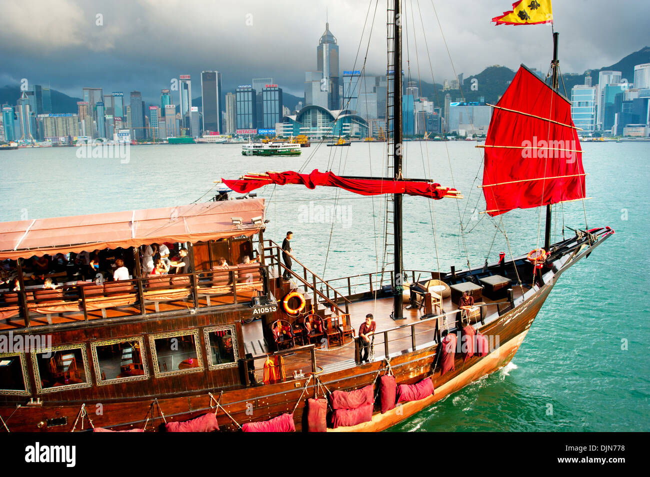 Traditional chinese-style tourist junk sailing in Hong Kong harbor . - Stock Image