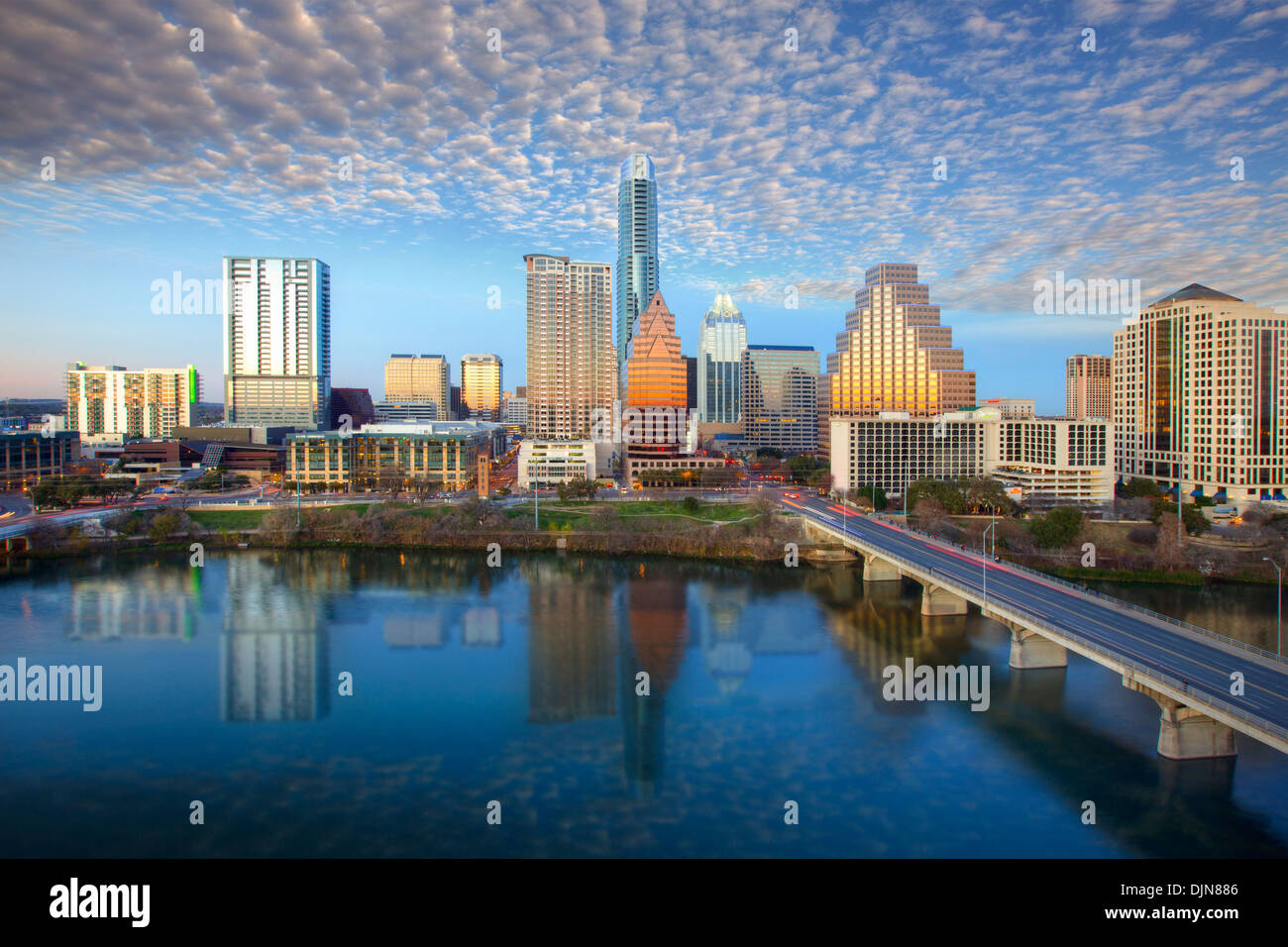 The Austin Skyline in Austin, Texas, shines on a late afternoon. The iconic Austin highrises are reflected in Lady Bird Lake. - Stock Image
