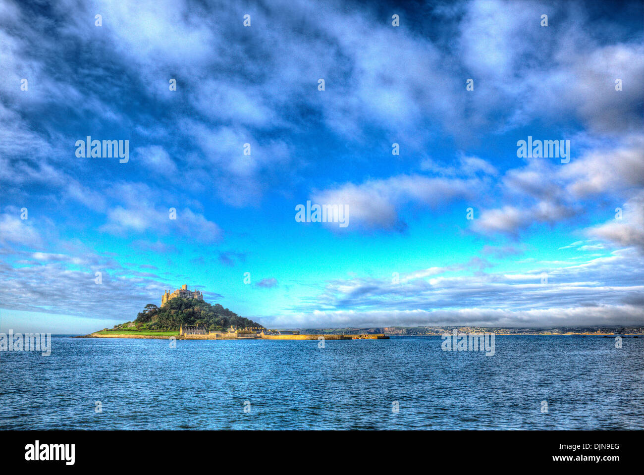 Medieval castle on island St Michaels Mount Cornwall England with vivid Cloudscape in HDR like painting - Stock Image