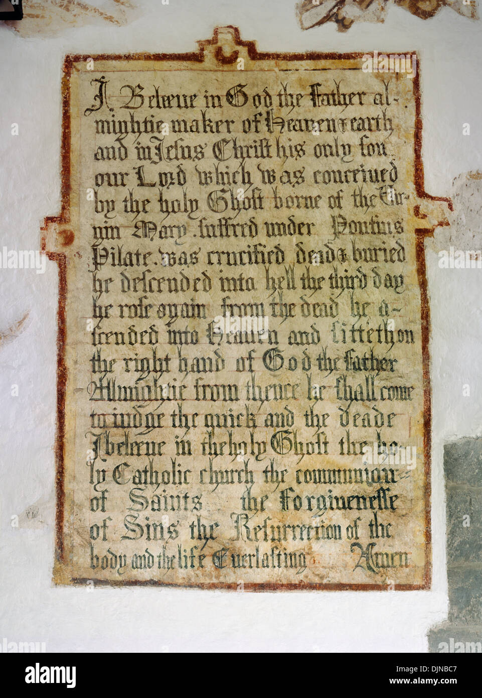 Text of the Apostles' Creed (C4th statement of Christian belief) painted on N wall of the nave of St Issui's Church, Partrishow, Powys: 1662 version. - Stock Image