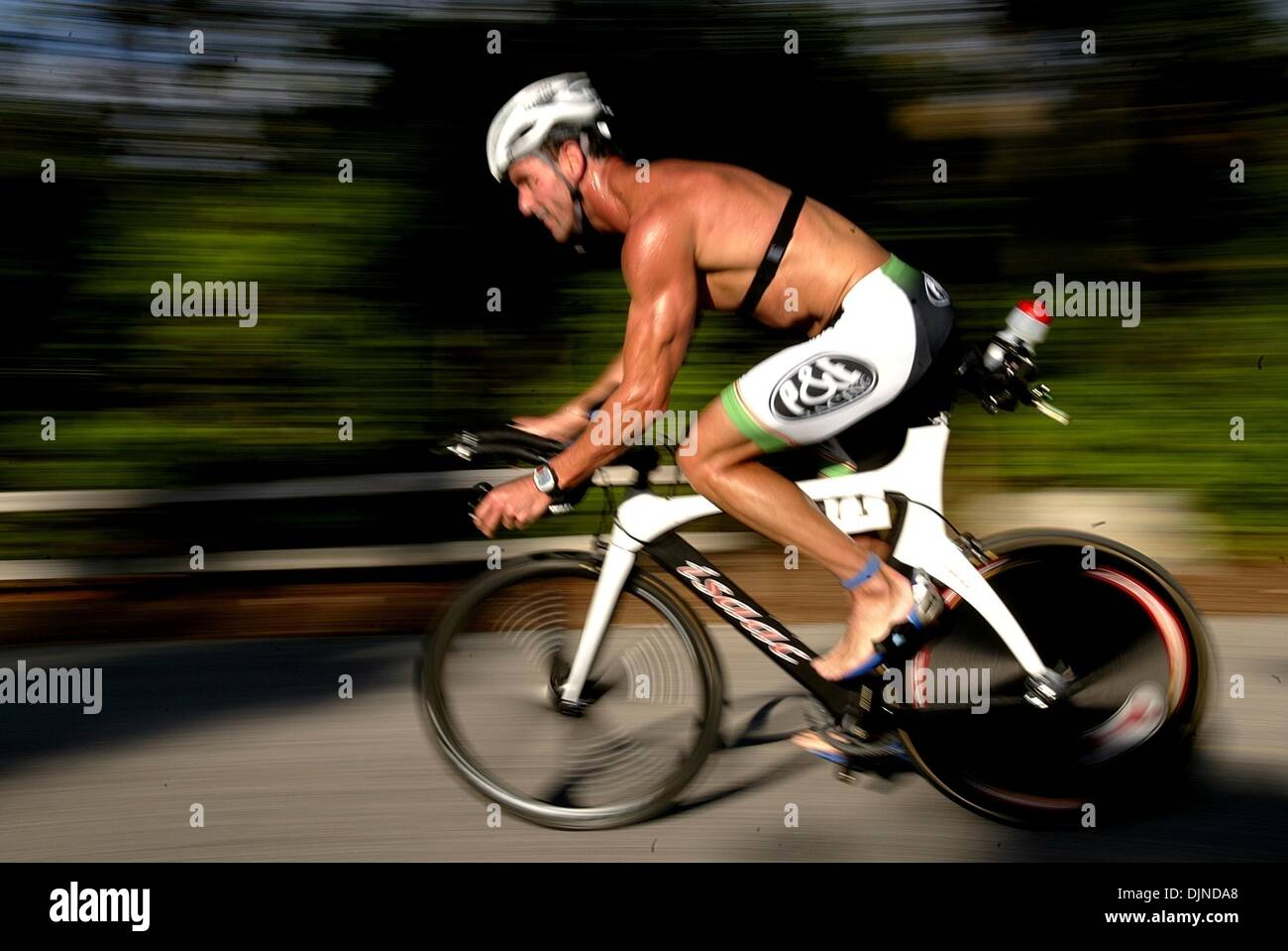 Apr 13, 2008 - Boca Raton, Florida, USA - ANDREW STEINER (371), 32, of Lake Worth, pulls into make the change to the 3.1 mile run during the 17th annual Florida Atlantic University Wellness Triathlon at Spanish River Park in Boca Raton Sunday. Over 700 triathletes competed in the quarter mile swim, ten mile bike and 3.1 mile run. (Credit Image: © Gary Coronado/Palm Beach Post/ZUMA - Stock Image