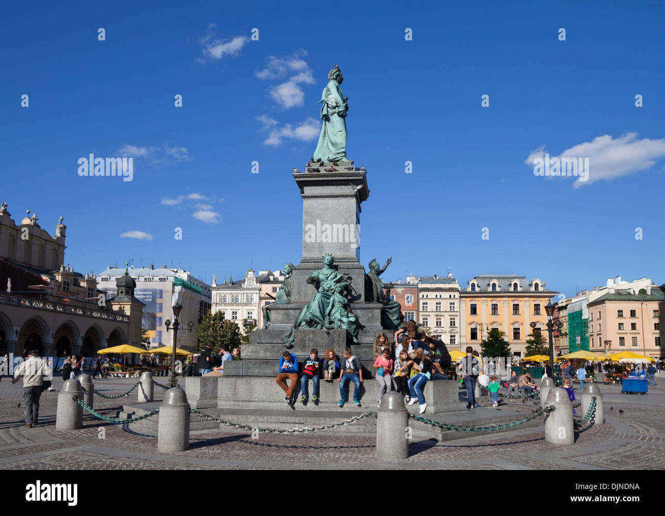Adam Mickiewicz Sculpture, Romantic poet. A meeting place in Rynek Glowny The Main Market Square,  Old Town, Krakow, Stock Photo