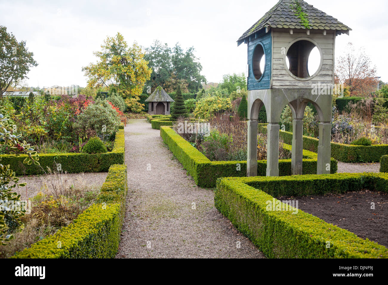 Box hedges and Yew trees in The gardens at Bridgemere Nursery and Garden World Cheshire England UK - Stock Image