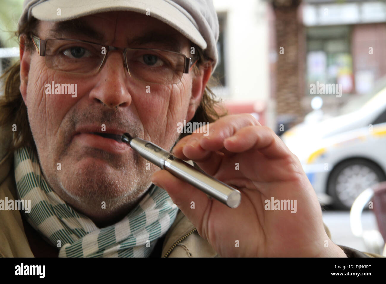 Older Man Smoking e cigarette - Stock Image