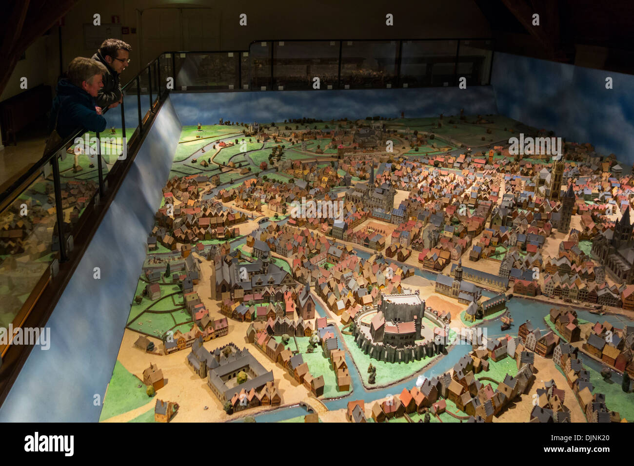 Visitors looking at scale model of the medieval city Ghent in the natural history museum Kina / Wereld van Kina, Belgium - Stock Image
