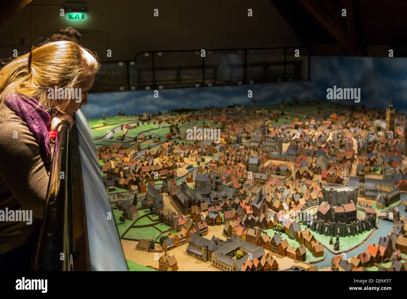 Visitors looking at scale model of the mediaeval city Ghent in the natural history museum Kina / Wereld van Kina, Belgium - Stock Image