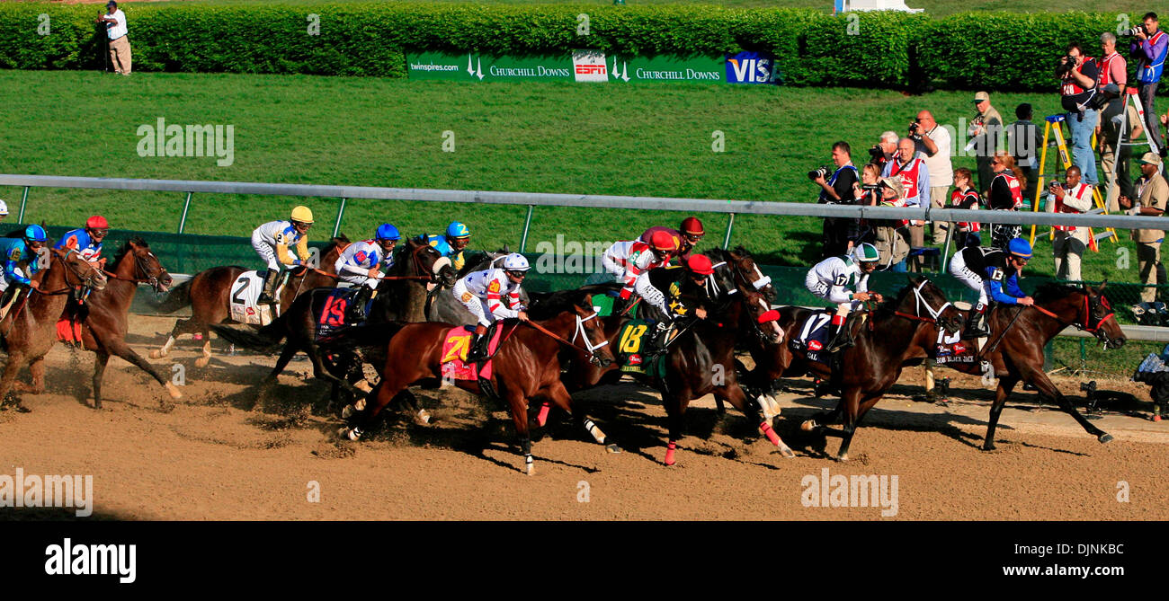 The field of horses pass the finish line on the first time by in the