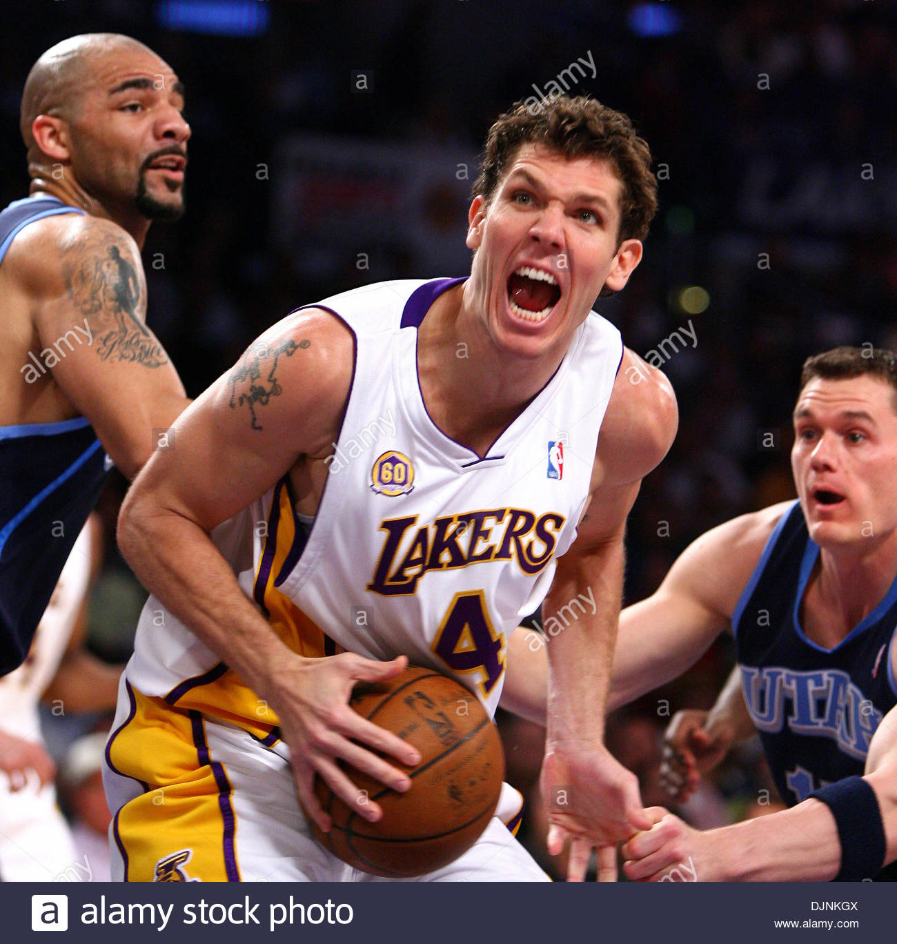 26ee8906a Los Angeles Lakers Luke Walton looks to put up a shot under pressure from Utah s  Carlos