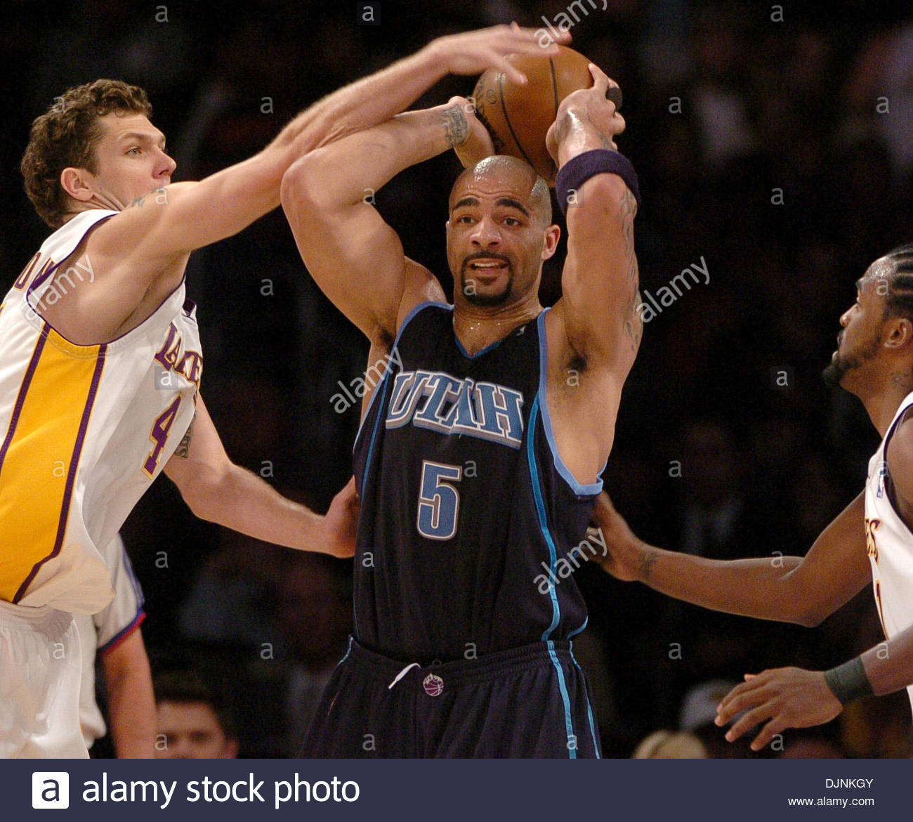 4e85a1ac2 Los Angeles Lakers Luke Walton and Ronny Turiaf defend Utah s Carlos Boozer  during Game 1 of