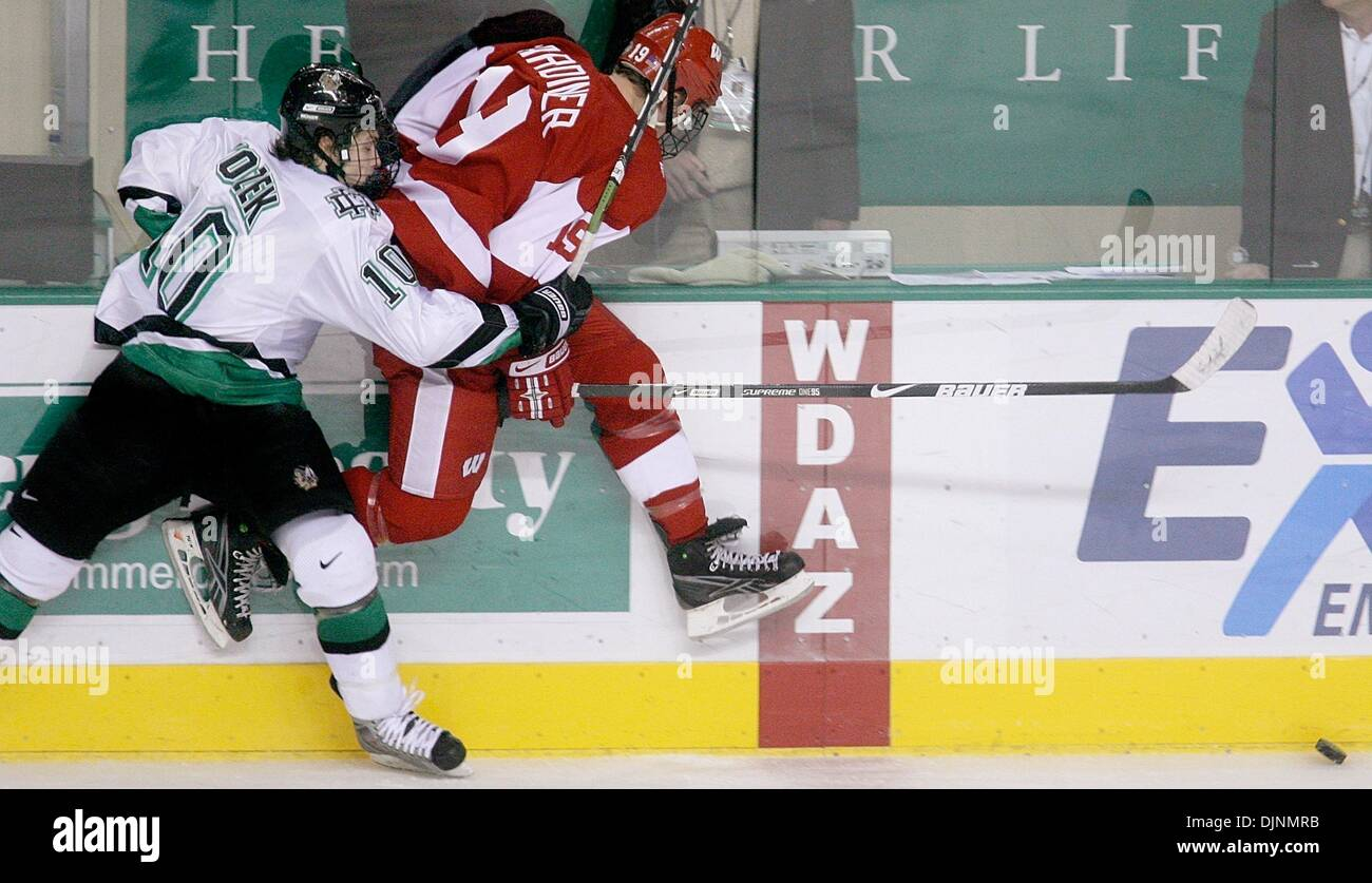 Oct 31, 2008 - Grand Forks, North Dakota, USA - North Dakota's ANDREW KOZEK, left, slams Wisconsin's EVAN TRUPP into the boards late in the third period of their NCAA hockey game at Ralph Engelstad Arena. North Dakota Fighting Sioux beat the Wisconsin Badgers 3-2. (Credit Image: © Bruce Crummy/ZUMA Press) - Stock Image