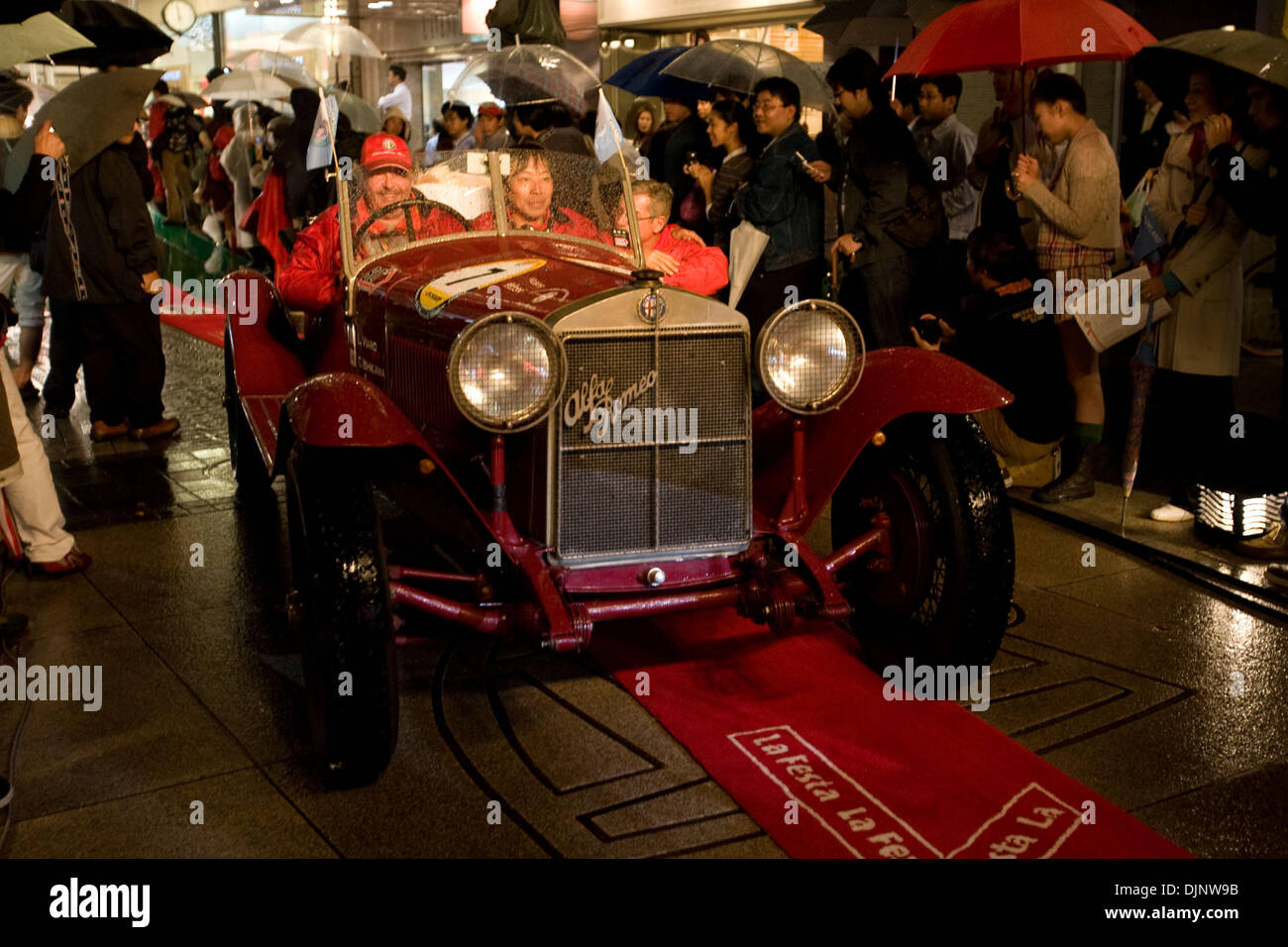 Oct 14, 2008 - Yokohama, Japan - The 12th annual La Festa Mille Miglia began on October 11th 2008 in the Harajuku district of Tokyo and finished on October 14 in the Motomachi district of Yokohama. The La Festa Mille Miglia is a 1000-mile classic car rally event that takes place every year in Japan with participants averaging the age of over 50. PICTURED: A foreign participant of t - Stock Image