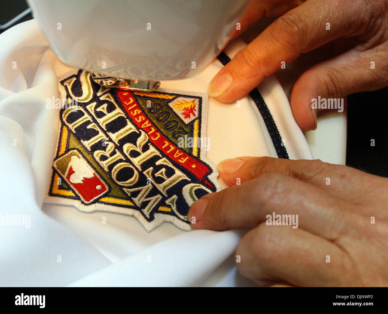 SP_296227_KEEL_RAYS (10/20/2008 ST. PETERSBURG) 2. A World Series patch is sewn on Evan Langoria's uniform by Diane Ellerman, (CQ), of St. Petersburg, who is the Rays seamstress. (Credit Image: © St. Petersburg Times/ZUMA Press) - Stock Image