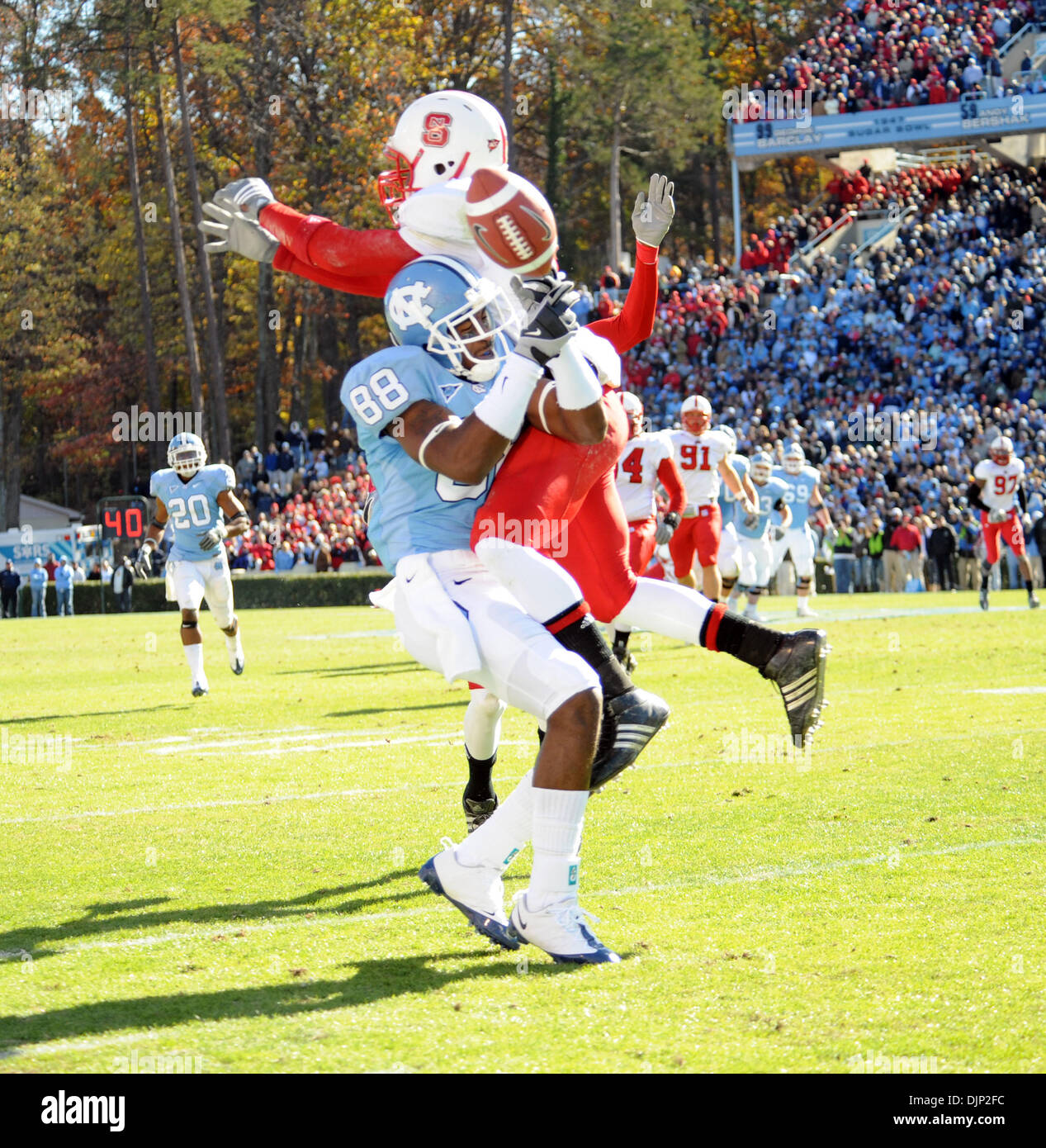 Nov 22, 2008 - Chapel Hill, North Carolina, USA - NCAA Football: Carolina Tarheels (88) HAKEEM HICKS attempt to catch a pass as North Carolina State Wolfpack (19) CLEM JOHNSON tries to intercept to pass as the North Carolina State Wolfpack defeat the University of North Carolina Tarheels with a final score of 41-10 as they play mens college football at Kenan Stadium located in Chap - Stock Image