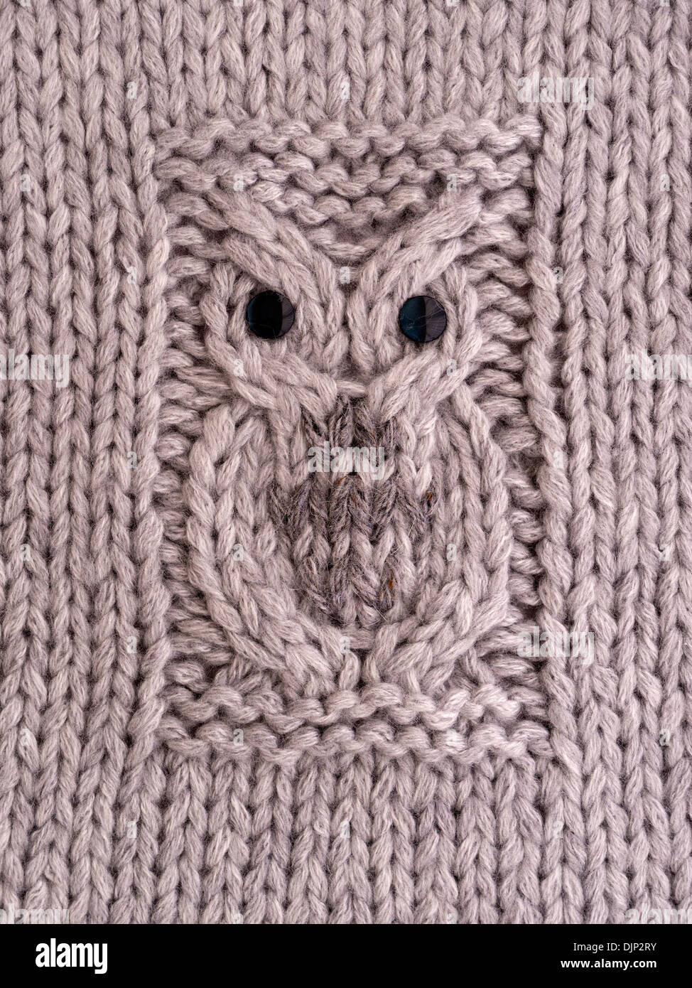 Hand knitted Owl motif pattern on cushion cover in grey wool Stock ...