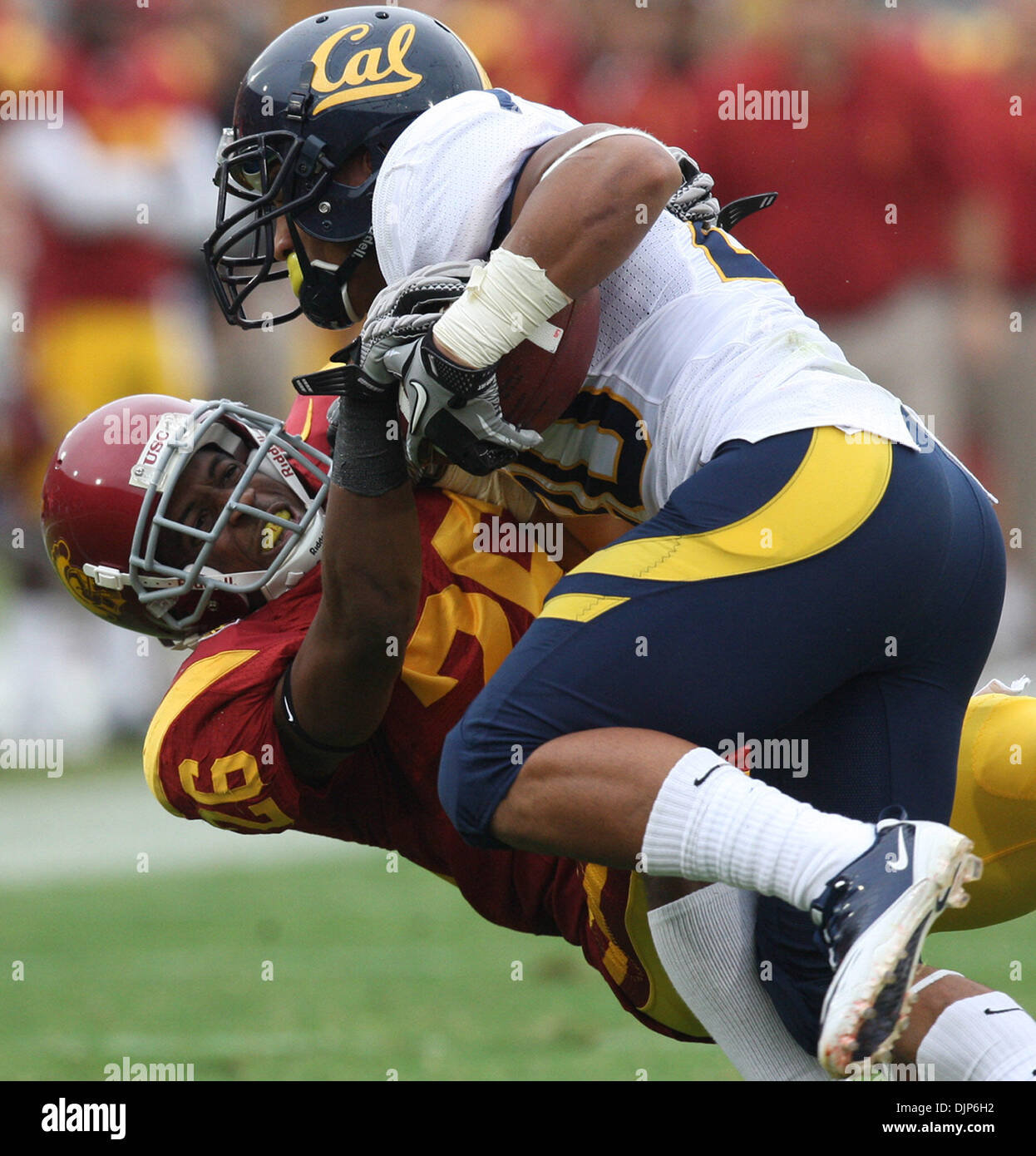 Apr. 10, 2008 - Los Angeles, California, U.S. - Southern California cornerback Daniel Harper (26) tackles California running back Isi Sofele (20) for a loss of yards in the first half during a NCAA, PAC 10 football game at the Los Angeles Memorial Coliseum on Saturday, October 16, 2010, in Los Angeles. (SGVN/Staff Photo by Keith Birmingham/SPORTS) (Credit Image: © San Gabriel Valle - Stock Image