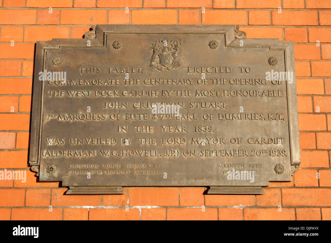 A plaque commerating the 100th anniversary of the opening of the Cardiff west dock on the Pierhead building Stock Photo