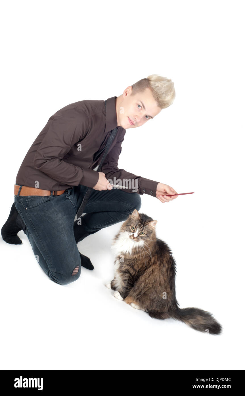 Portrait of handsome man with cat - Stock Image