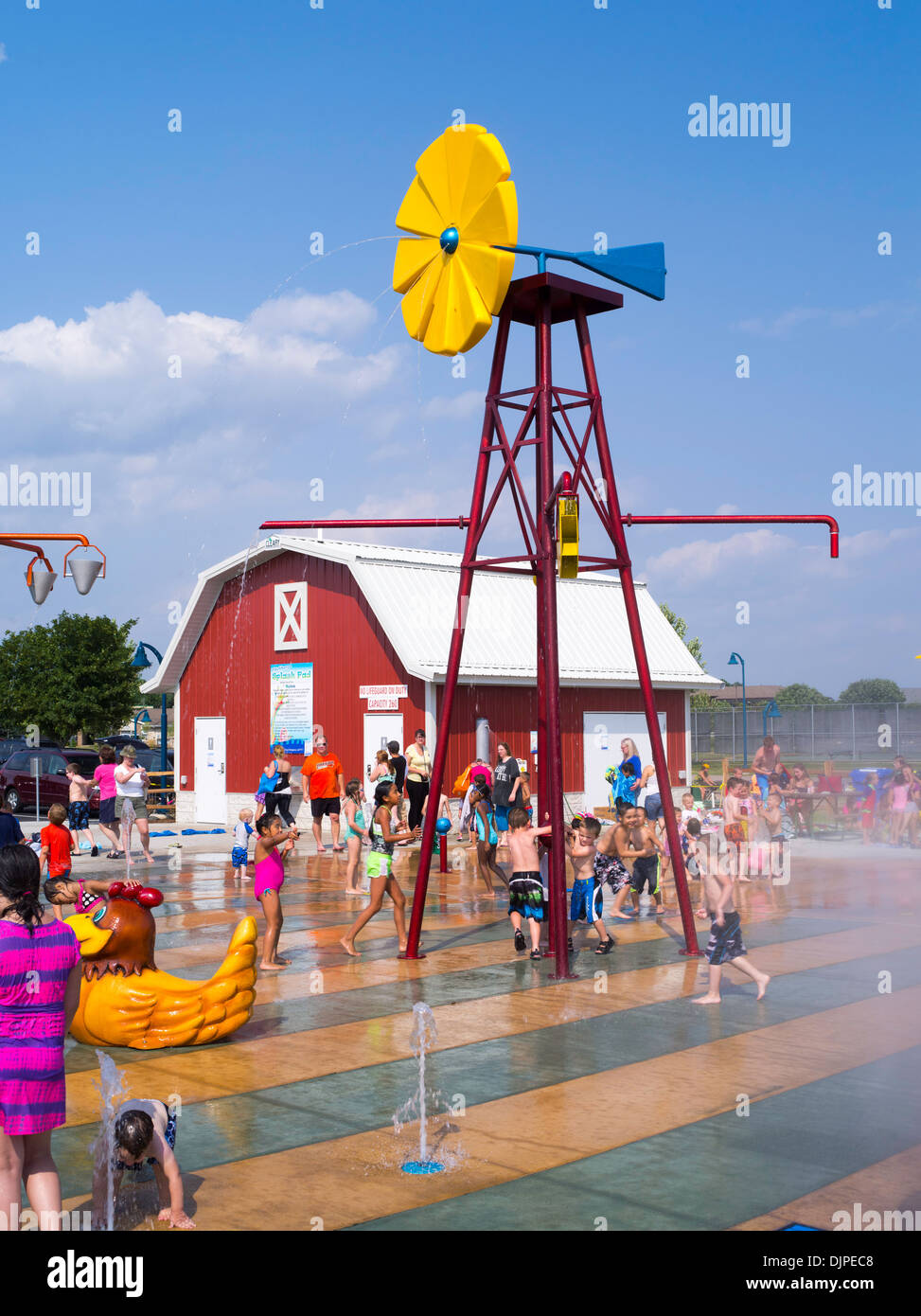 Children and adults play at the new Splash Pad located at McKee Farms Park, Fitchburg, Wisconsin, USA - Stock Image
