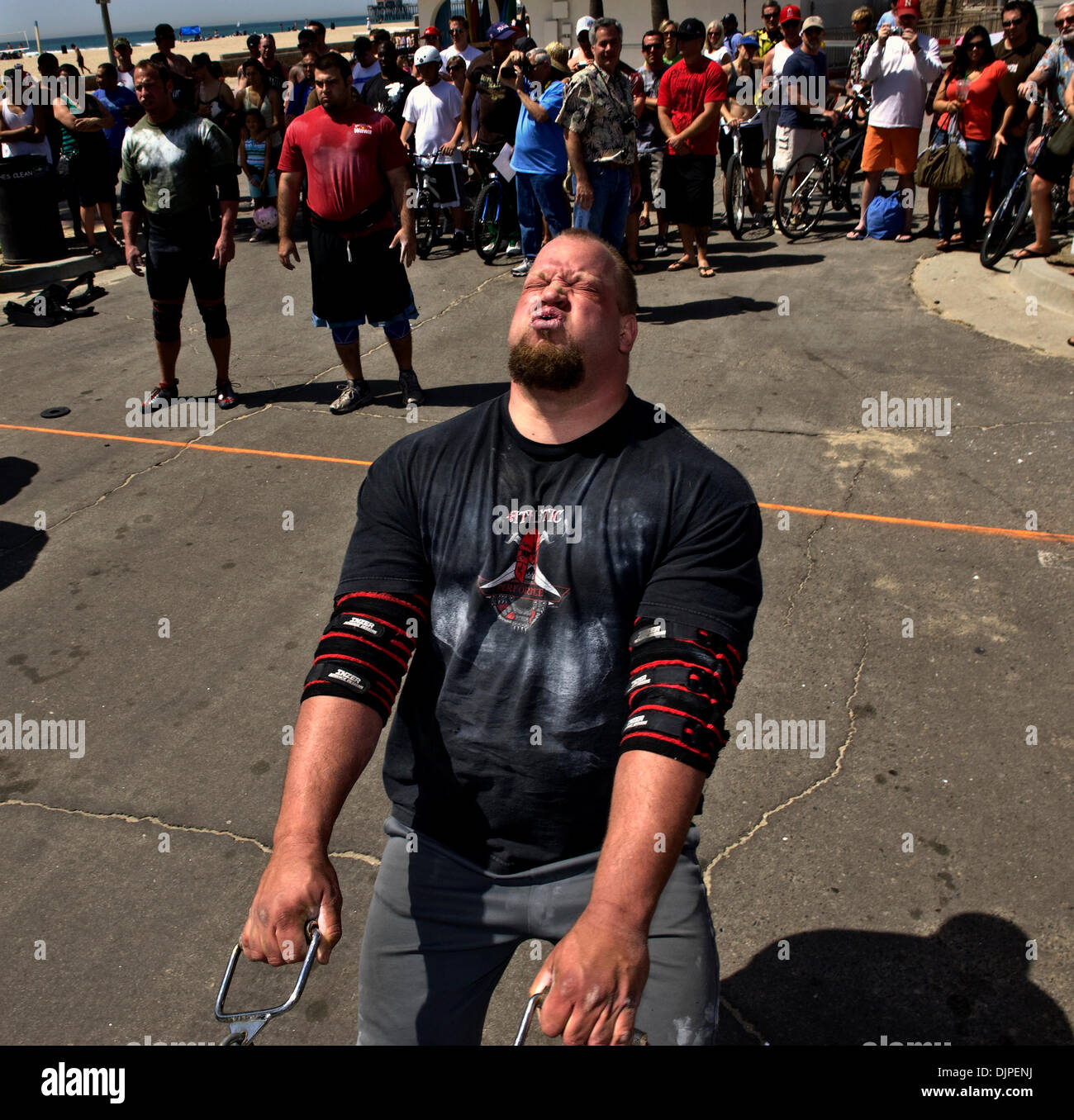 March 27, 2010 - Huntington Beach, California, USA -  CHARLES STUMPF competes in the sled pull, the last of the Stock Photo