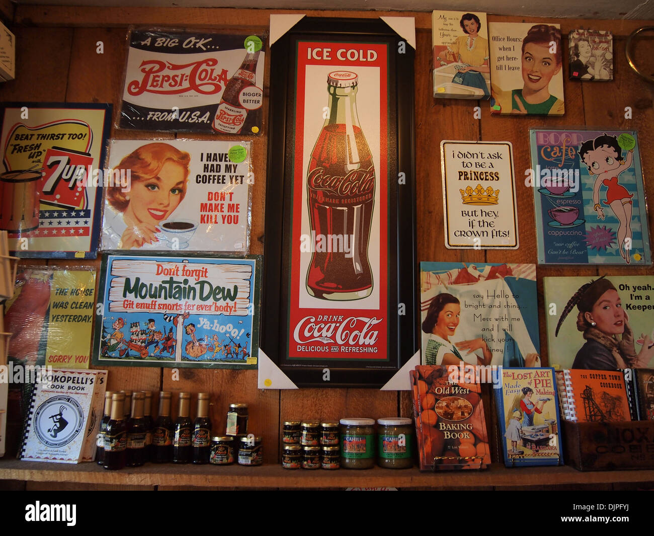 Various vintage advertisement signs on display at the Gold King Mine gift shop in Jerome, Arizona, USA - Stock Image