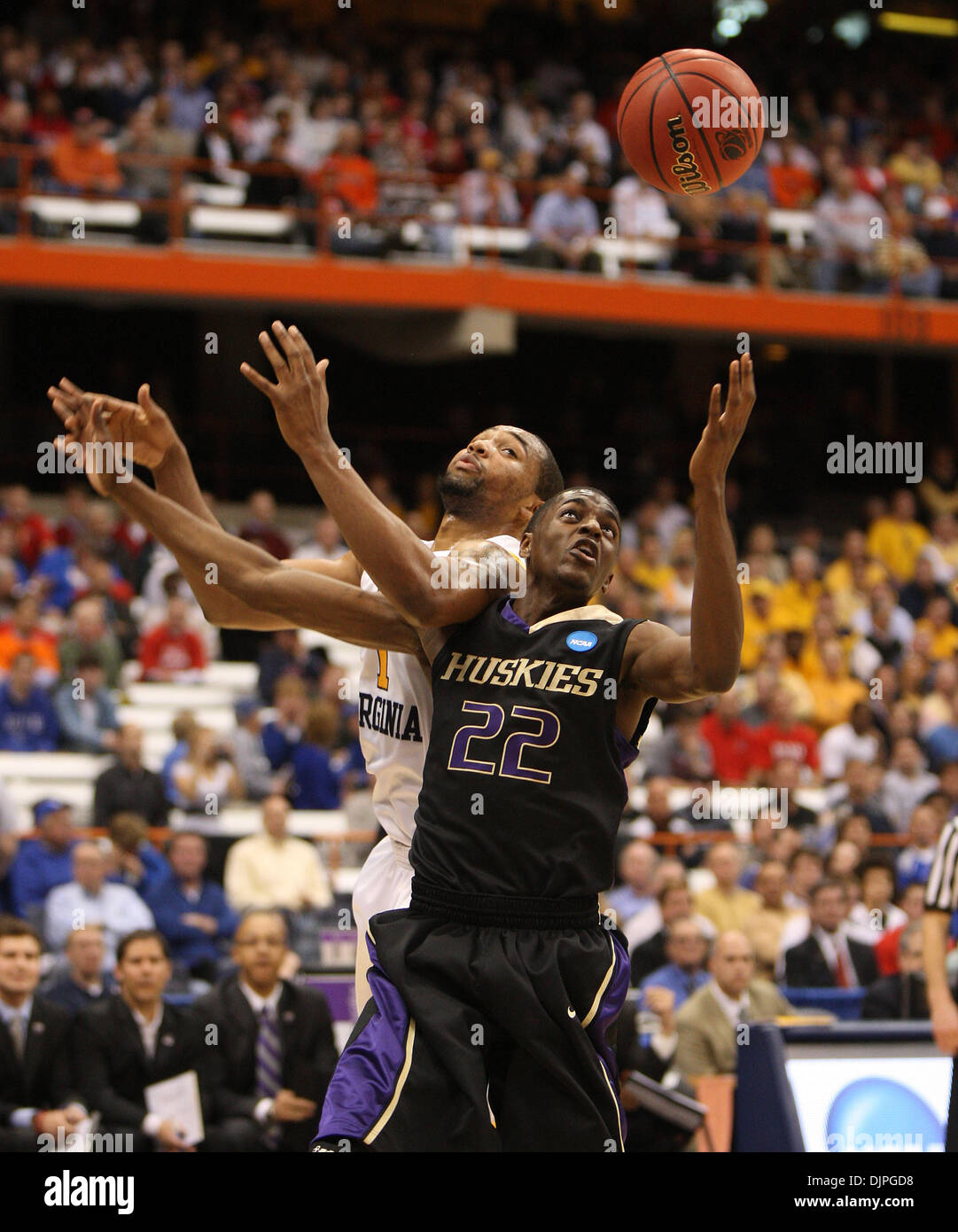 Mar. 25, 2010 - Syracuse, New York, U.S. - West Virginia's 1- DA'SEAN BUTLER and Washington's JUSTIN HOLIDAY battled for a rebound as West Virginia played Washington during the NCAA tournament, March Madness at the Carrier Dome. Washington played West Virginia during the Sweet 16 bracket game.  (Credit Image: © Charles Bertram/Lexington Herald-Leader/ZUMApress.com) - Stock Image