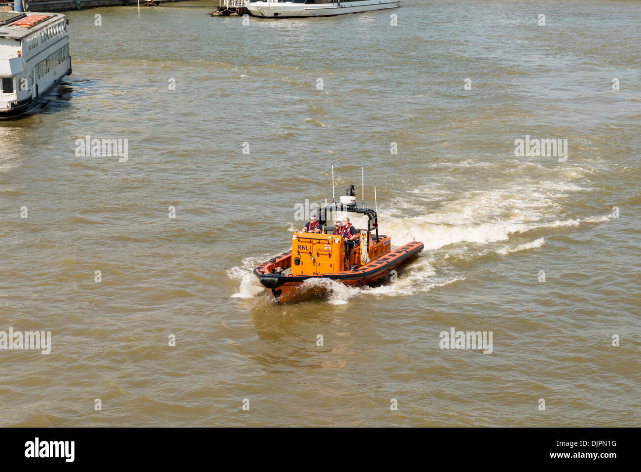 Lifeboat and crew in the River Thames Stock Photo