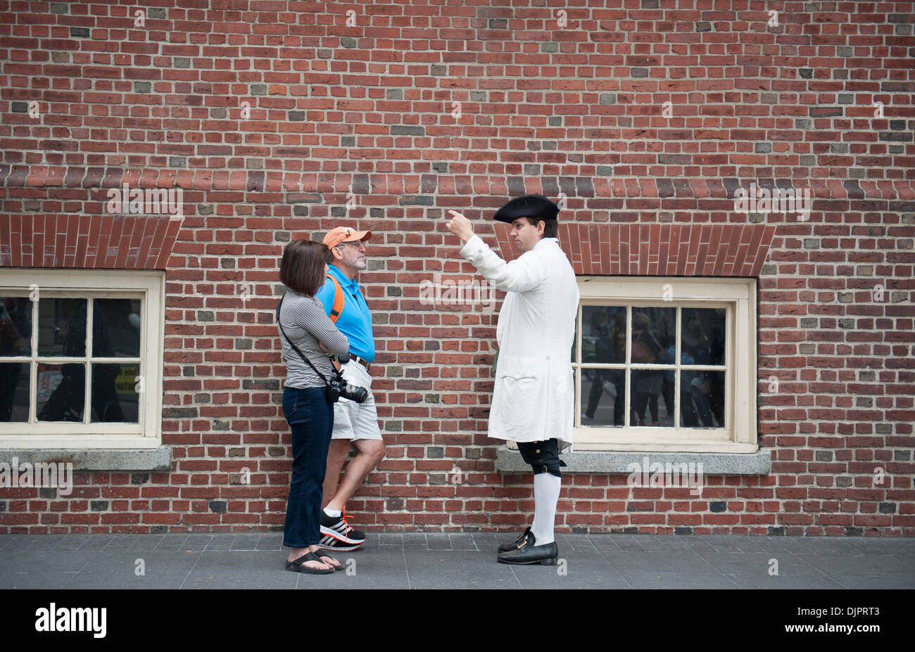 Outside the Old State House in Boston, a costumed interpreter talks to tourists. Oct. 3, 2013 - Stock Image