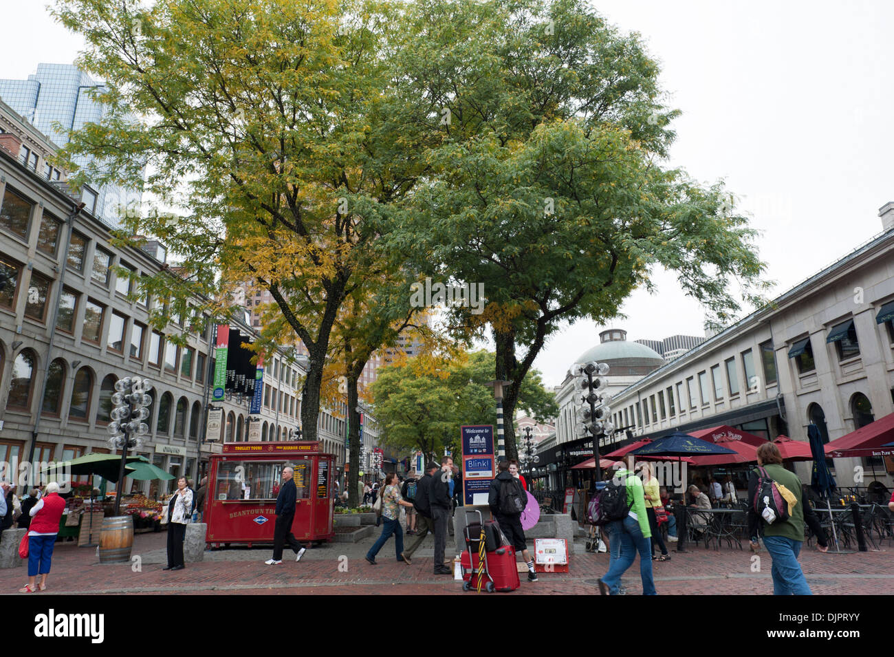 The plazas around Boston's historic Faneuil Hall and Quincy Market are filled with fast food vendors and tourism merchandise. - Stock Image
