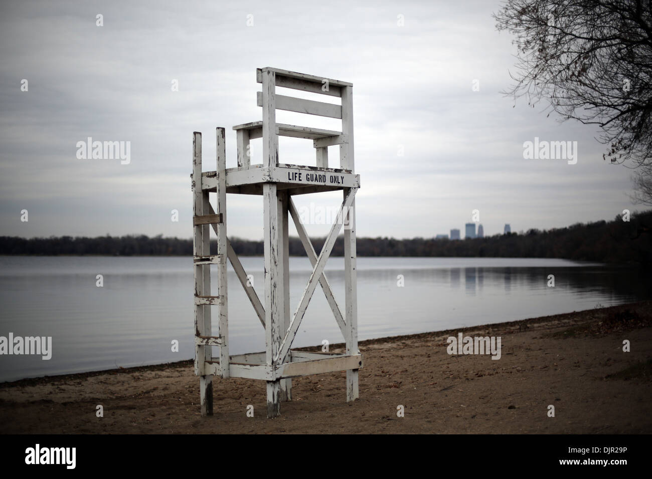 An empty lifeguard stand near a lake in Minneapolis in the off season. - Stock Image