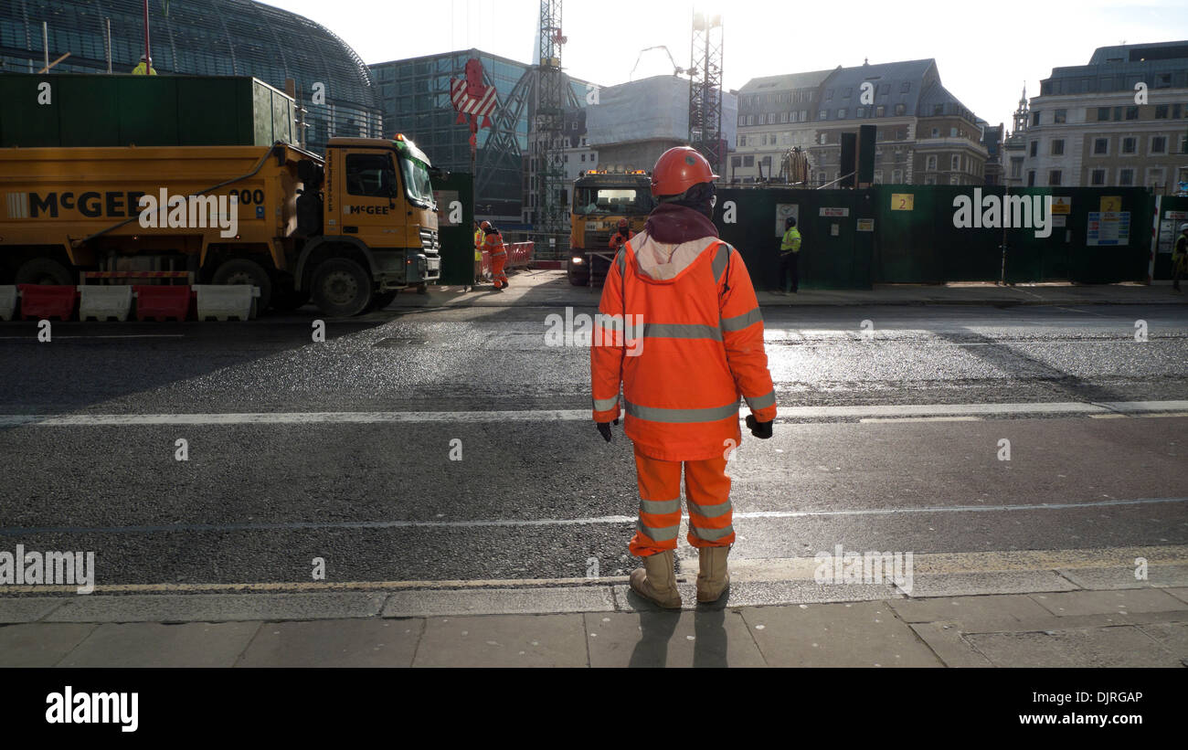 Worker at entrance to Bloomberg Place construction site on Queen Victoria Street in the City of London England UK   KATHY DEWITT - Stock Image