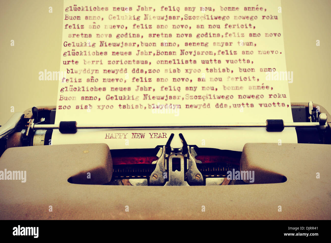 happy new year written in different languages with an old typewriter, with a retro effect - Stock Image